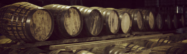 Casks of whisky maturing in a Scottish warehouse