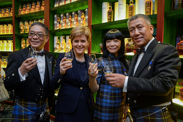 Mud in yer eye! Current SNP leader Nicola Sturgeon promotes Scotch at the 2015 opening of Beijing's Whisky Experience Centre